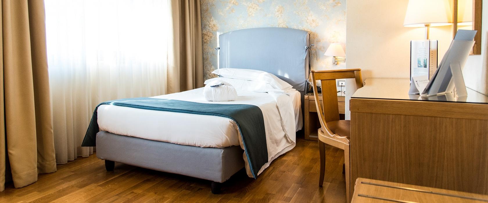 Camera singola ricca di comfort all'Hotel Touring